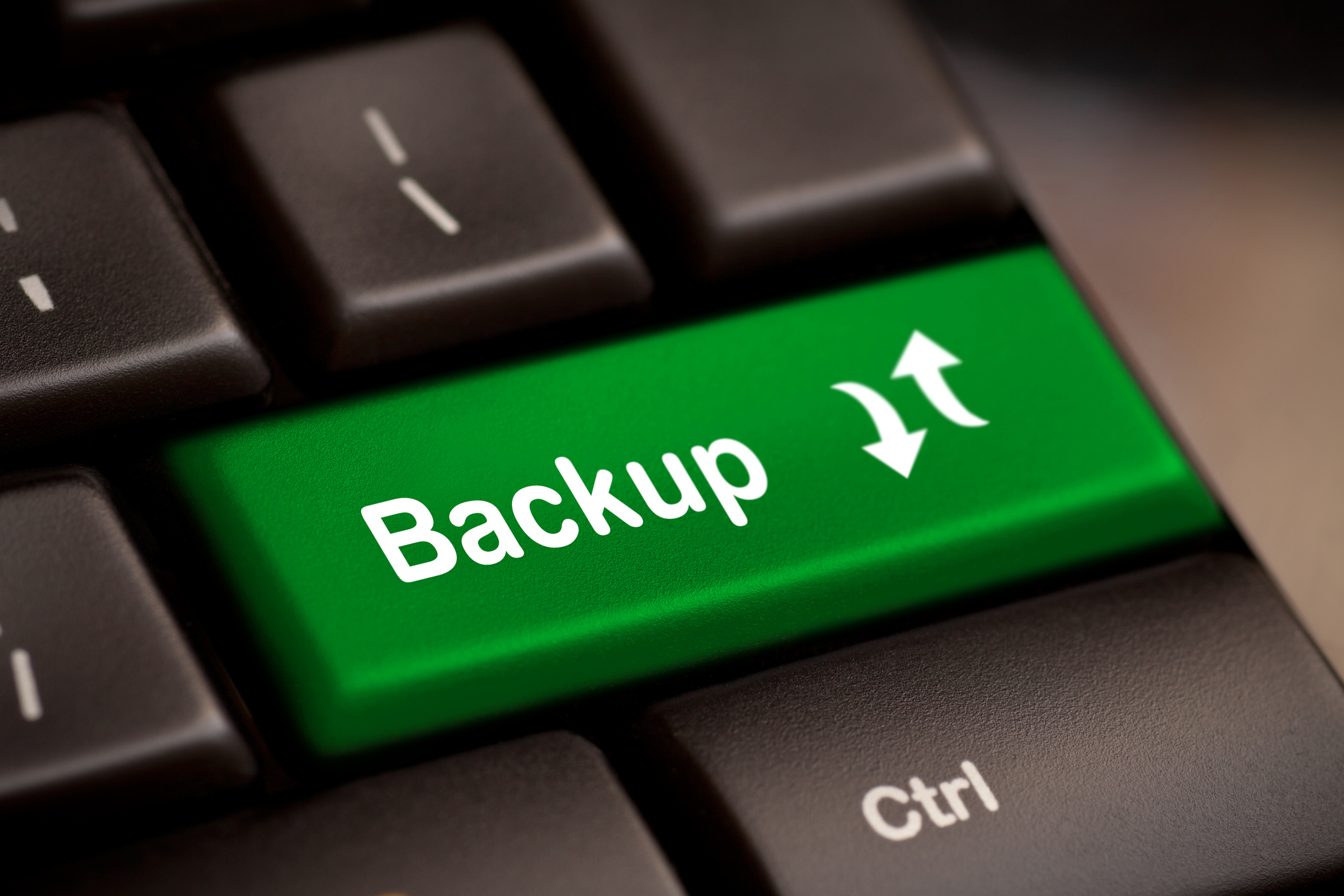 Backup Computer Key In Green For Archiving And Storage